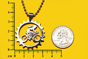 female biker in chain ring pendant